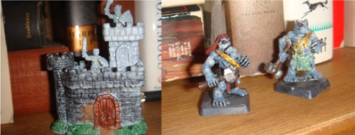 I've even roped my boys into the act. The castle on the left is a Work in Progress authored by Younger Boy; on the right are two rock-like warriors (from the game Wargods of Aegyptus, another one I keep meaning to try); anyway the fellow on the far right is the work of Older Boy.