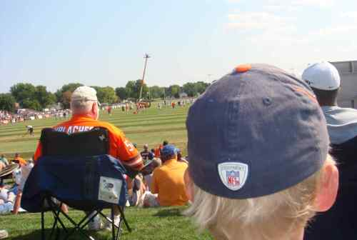 Younger Son did not complain about the view from behind the wide Urlacher fan.